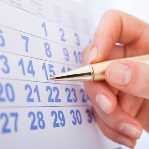 Hand circling important date on the calendar