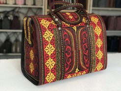 Mulia handmade travel bag in black red yellow