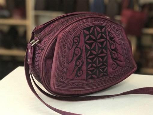 ria handmade cross body in burgundy and black