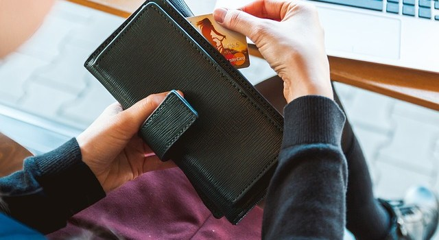 A wallet with a credit card.
