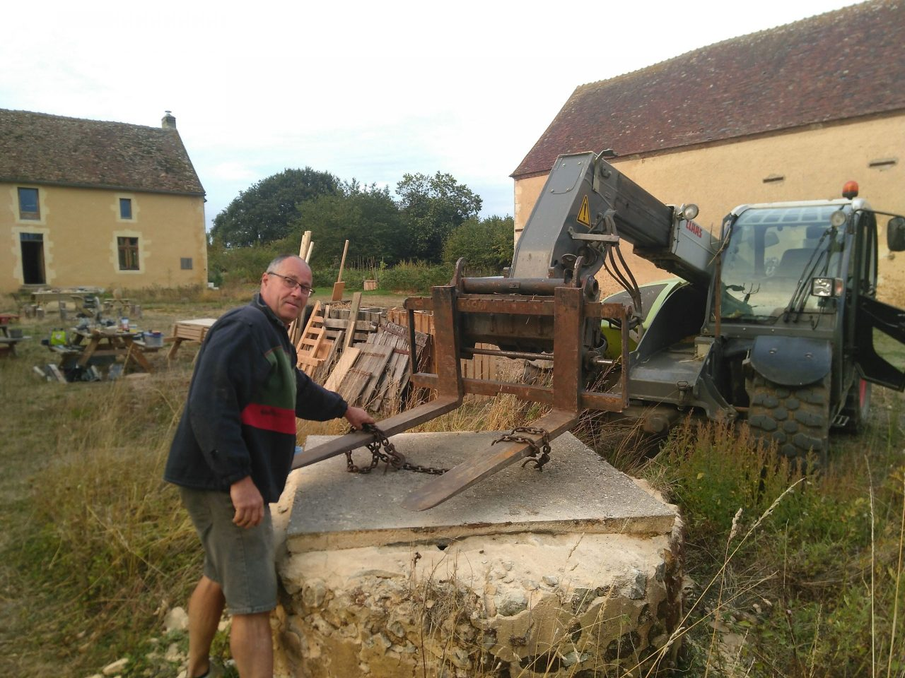 Our neighbour opening up the well with his tractor