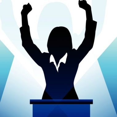 Business/political Speaker Silhouette Behind A Podium