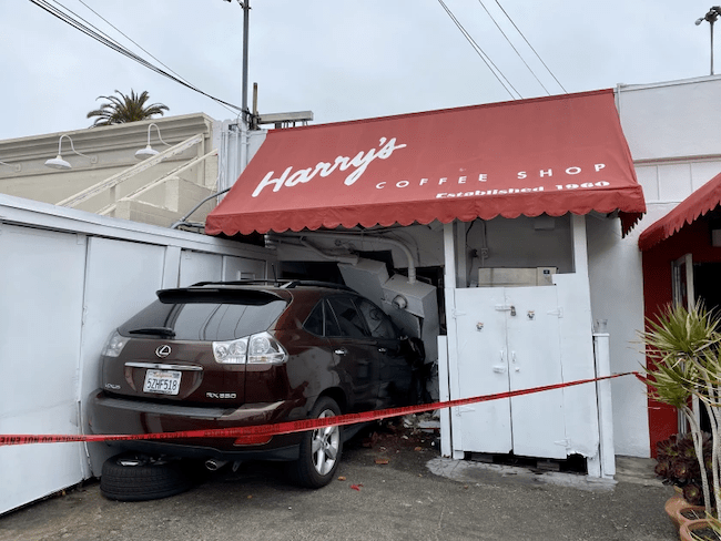 An SUV crashed into Harry's Coffee Shop