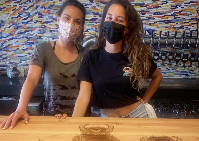 Bartenders wearing masks in San Diego