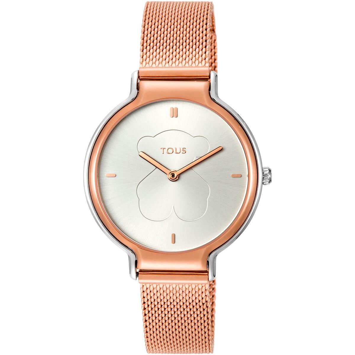 Reloj Tous con cadena de malla de acero en color rosa y esfera combinada en color rosa y plata. Fondo de la esfera en color plata con los indices y agujas en color rosa