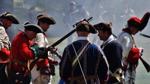 French and Indian War reenactors gathered in Lake George to commemorate the siege and surrender of Fort William Henry with battle reenactments.