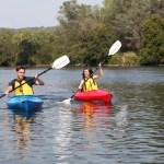 People using kayaks on Lake George