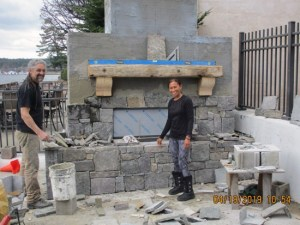 construction of massive stone fireplace
