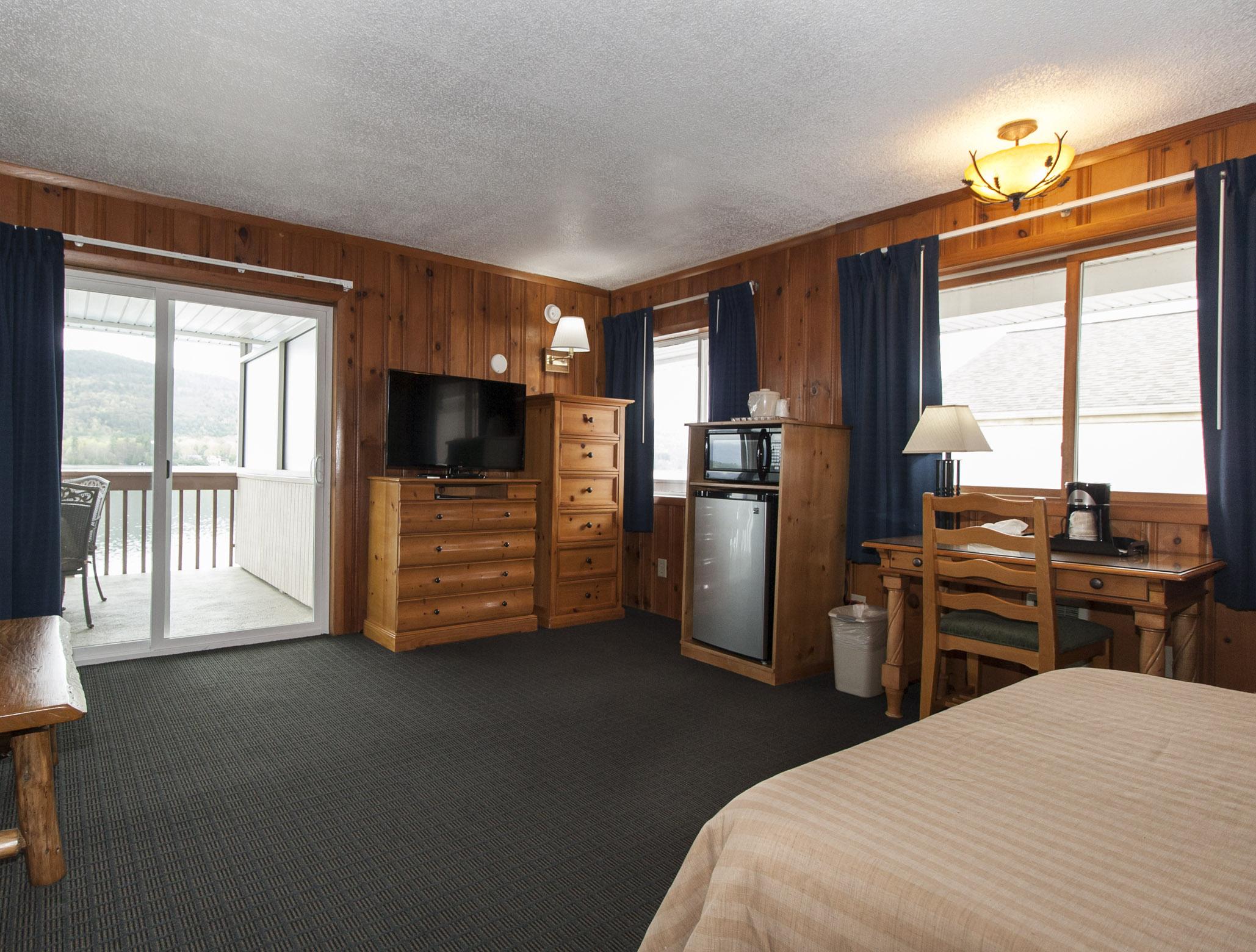 Lake Motel Room with sliding glass door to balcony