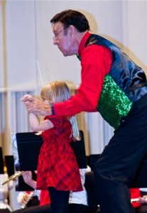 Vic Larsen and a young child conduct the Lakeland Concert Band