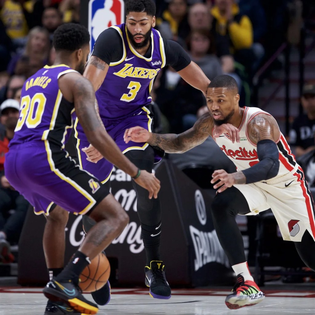 Troy Daniels, Anthony Davis and Damian Lillard. Los Angeles Lakers vs Portland Trail Blazers