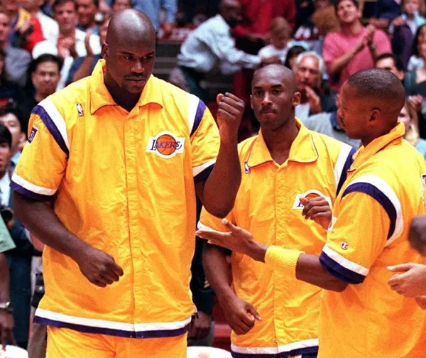 Shaquille O'Neal, Kobe Bryant and Byron Scott. Los Angeles Lakers vs Philadelphia at The Forum in Inglewood on October 18, 1996