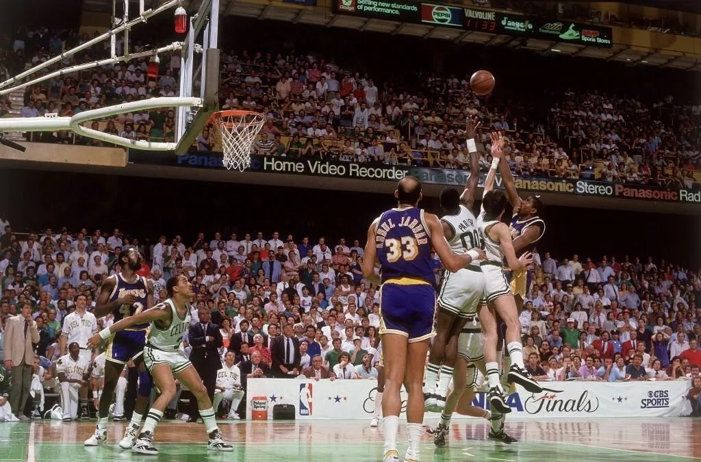 Basketball: NBA Finals: Los Angeles Lakers Magic Johnson (33) in action, making junior sky hook shot during final seconds of game vs Boston Celtics Kevin McHale (32) and Robert Parish (00). Game 4 winning shot. Boston, MA 6/9/1987
