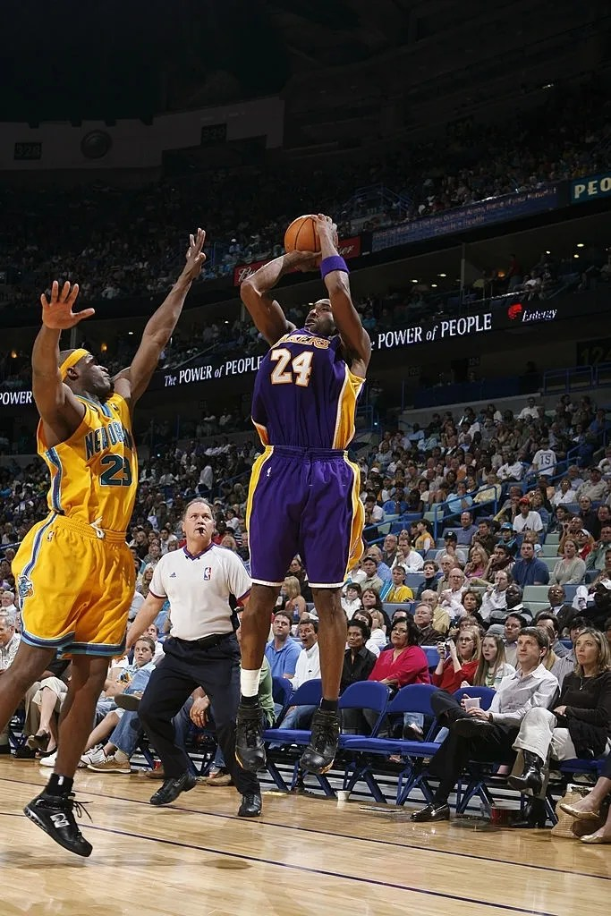 Kobe Bryant #24 of the Los Angeles Lakers takes a jump shot over Devin Brown #23 of the New Orleans/Oklahoma City Hornets at the New Orleans Arena on March 23, 2007 in New Orleans, Louisiana.