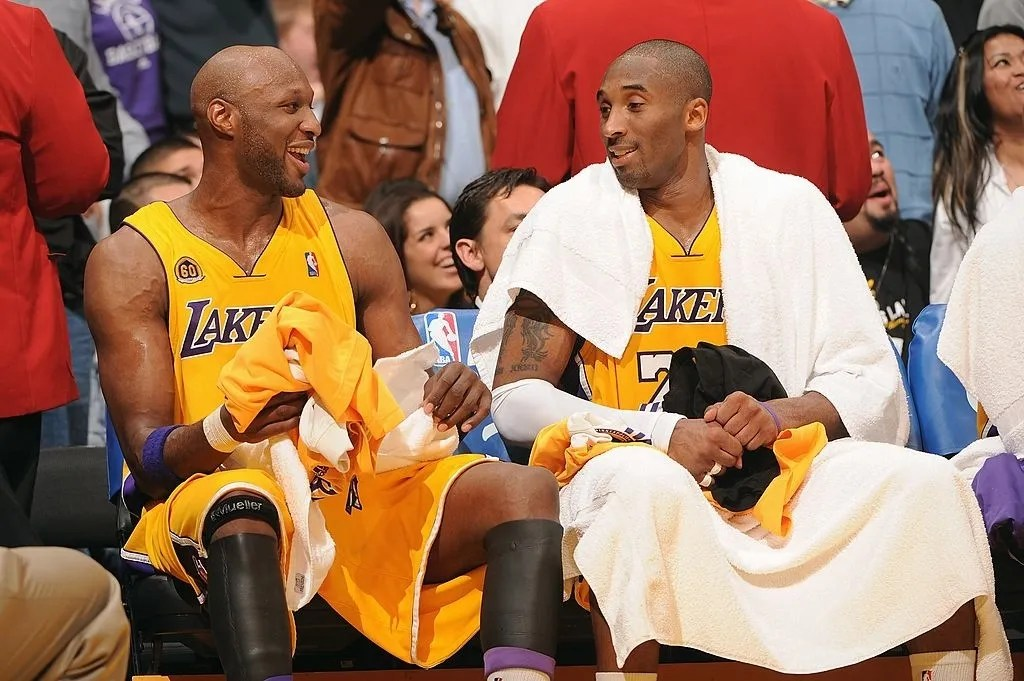 Lamar Odom #7 and Kobe Bryant #24 of the Los Angeles Lakers talk on the bench during the game against the Miami Heat at Staples Center on February 28, 2008 in Los Angeles, California. The Lakers won 106-88