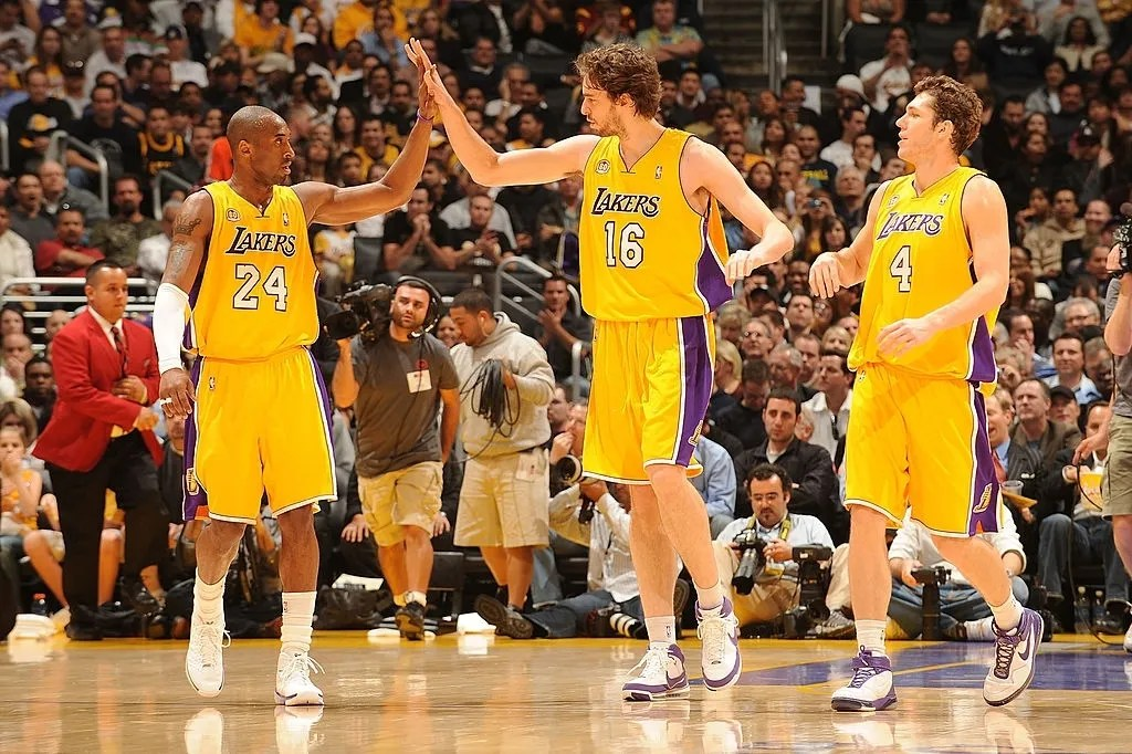 Kobe Bryant #24 of the Los Angeles Lakers high-fives teammate Pau Gasol #16, while teammate Luke Walton #4 looks on during their game against the Miami Heat at Staples Center February 28, 2008 in Los Angeles, California.