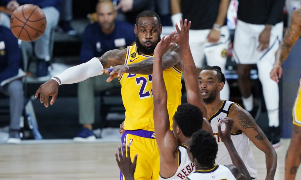 Los Angeles Lakers' LeBron James (23) passes the ball during the second half of an NBA basketball game against the Denver Nuggets, Monday, Aug. 10, 2020, in Lake Buena Vista, Fla.