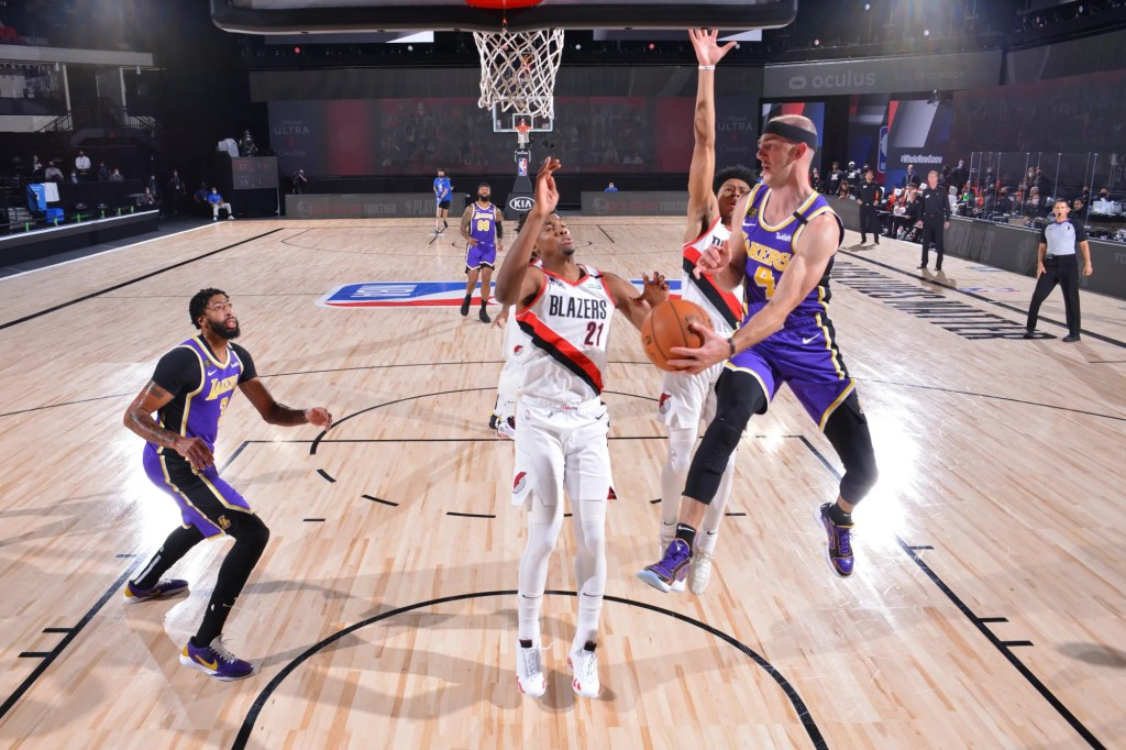 Alex Caruso #4 of the Los Angeles Lakers drives to the basket against the Portland Trail Blazers during Round One, Game Three of the NBA Playoffs on August 22, 2020