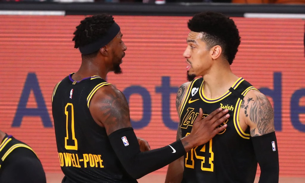 LAKE BUENA VISTA, FLORIDA - AUGUST 24: Danny Green #14 and Kentavious Caldwell-Pope #1 of the Los Angeles Lakers talk in the first half against the Portland Trail Blazers in game four of the first round of the 2020 NBA Playoffs at AdventHealth Arena at ESPN Wide World Of Sports Complex on August 24, 2020 in Lake Buena Vista, Florida. NOTE TO USER: User expressly acknowledges and agrees that, by downloading and or using this photograph, User is consenting to the terms and conditions of the Getty Images License Agreement.