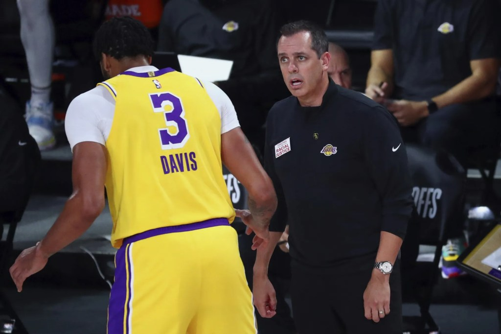 Los Angeles Lakers head coach Frank Vogel, right, talks with forward Anthony Davis (3) during the first half of Game 2 of an NBA basketball first-round playoff series against the Portland Trail Blazers, Thursday, Aug. 20, 2020, in Lake Buena Vista, Fla.