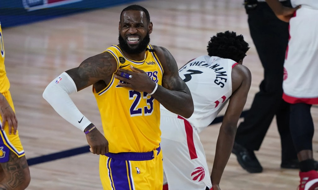 The Lakers' LeBron James reacts after a play against the Raptors during the second half Aug. 1, 2020. The Lakers' LeBron James reacts after a play against the Raptors during the second half. He finished with 20 points