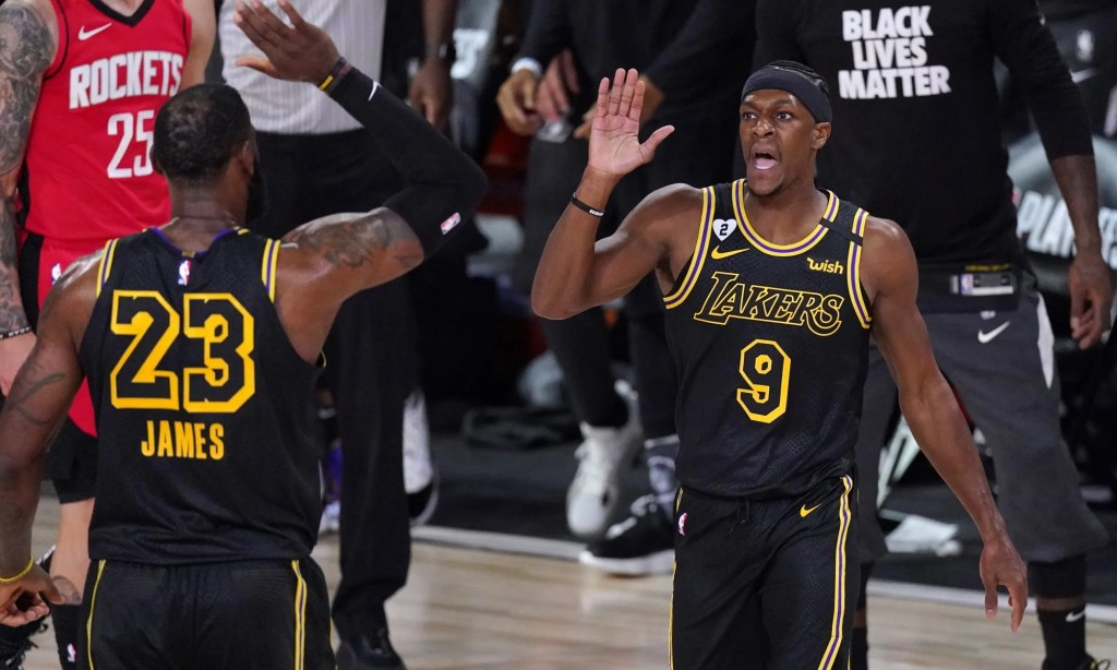 Los Angeles Lakers' Rajon Rondo (9) celebrates with LeBron James (23) after scoring a three-point basket against the Houston Rockets during the first half of an NBA conference semifinal playoff basketball game Sunday, Sept. 6, 2020, in Lake Buena Vista, Fla.