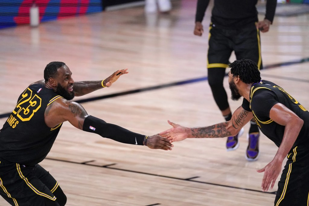 Los Angeles Lakers' LeBron James (23) celebrates with Anthony Davis during the second half of an NBA conference semifinal playoff basketball game against the Houston Rockets Sunday, Sept. 6, 2020, in Lake Buena Vista, Fla.