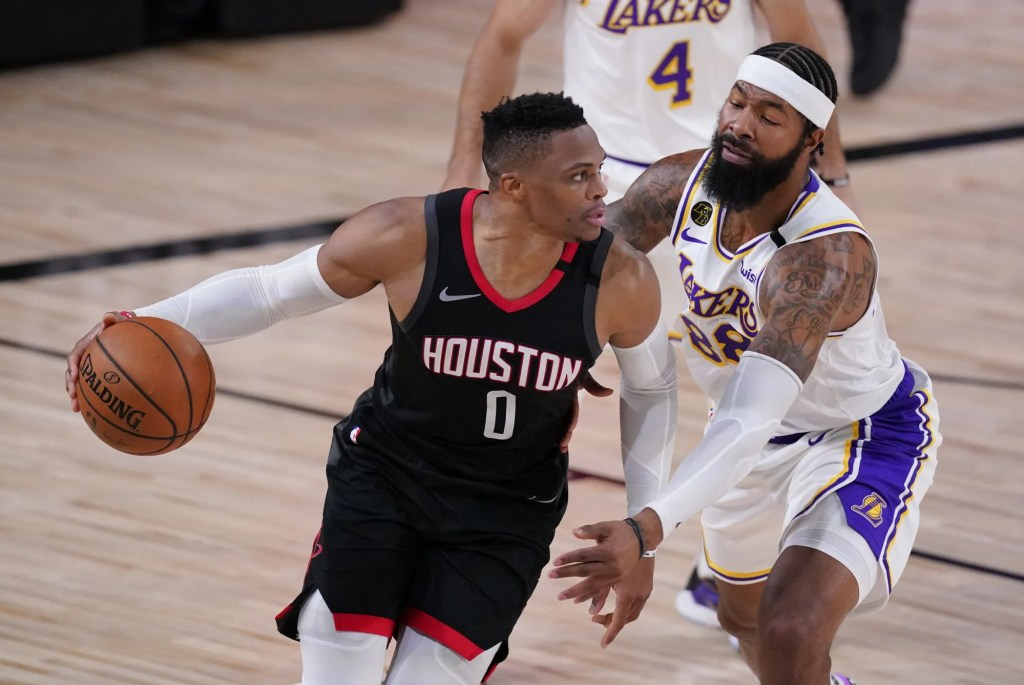 Houston Rockets' Russell Westbrook (0) drives around Los Angeles Lakers' Markieff Morris, right, during the first half of an NBA conference semifinal playoff basketball game Tuesday, Sept. 8, 2020, in Lake Buena Vista, Fla.