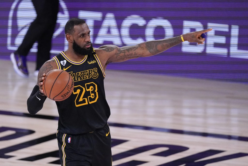 Lakers forward LeBron James directs his teammates during Game 2.