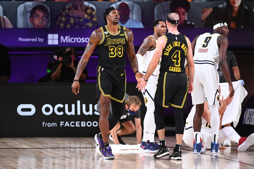 Dwight Howard #39 and Alex Caruso #4 of the Los Angeles Lakers hi-five during the game against the Denver Nuggets during Game Two of the Western Conference Finals on September 20, 2020