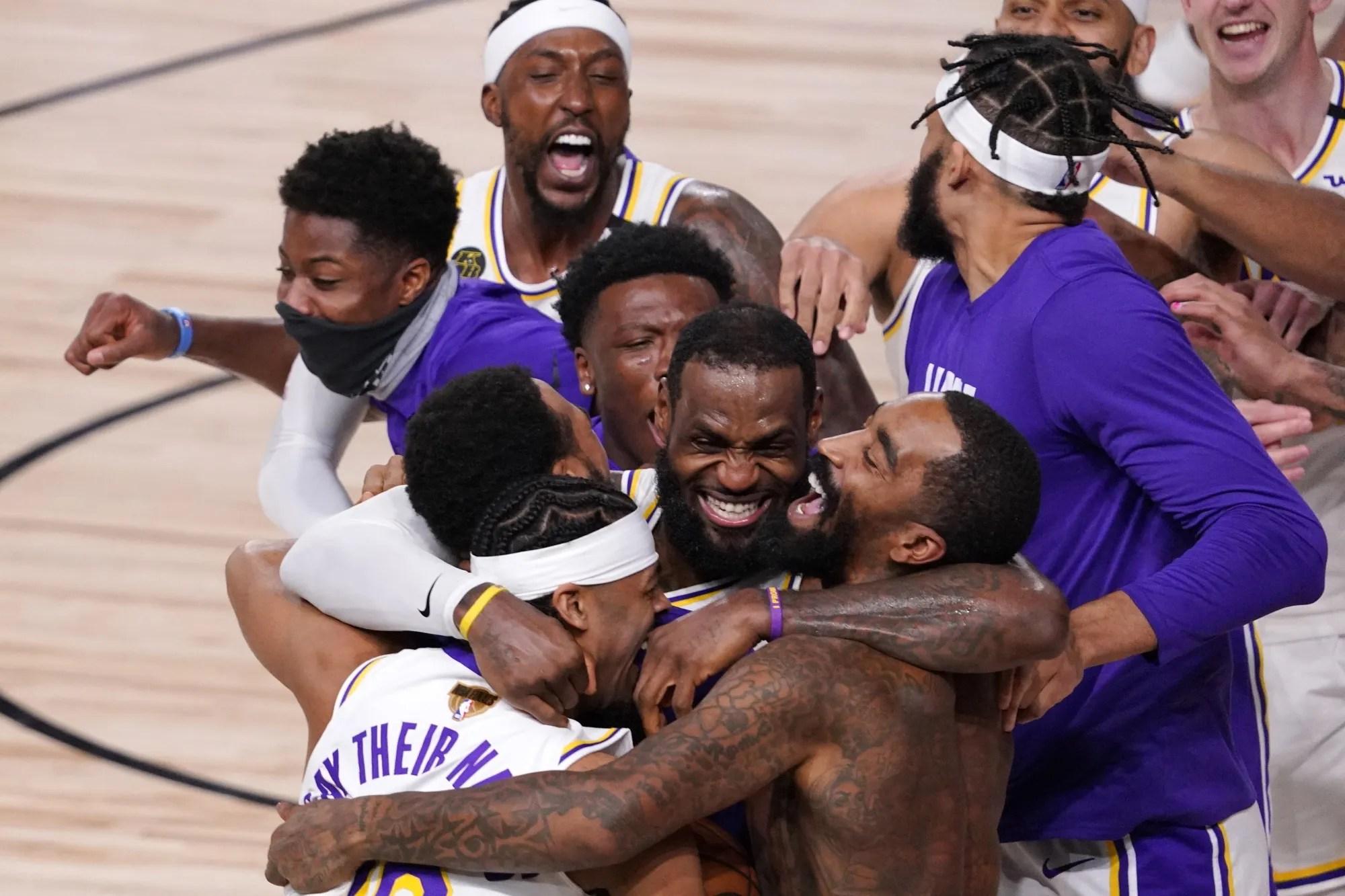 LeBron James celebrates with his teammates