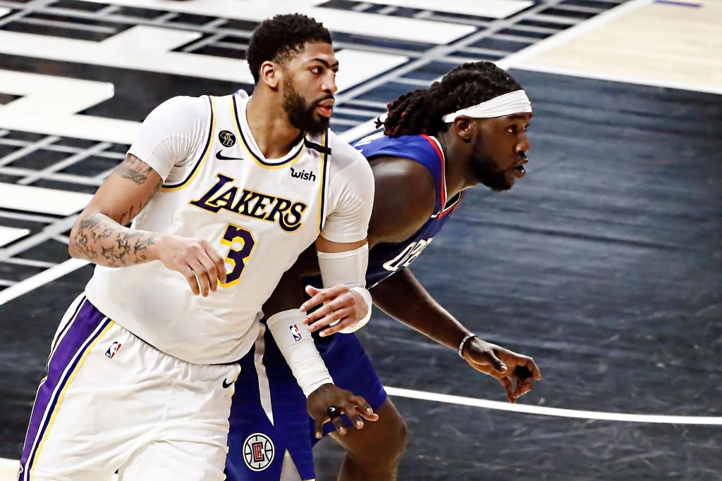 Montrezl Harrell #5 of the LA Clippers fights for position with Anthony Davis #3 of the Los Angeles Lakers during a game at the Staples Center on March 8, 2020 in Los Angeles, CA.