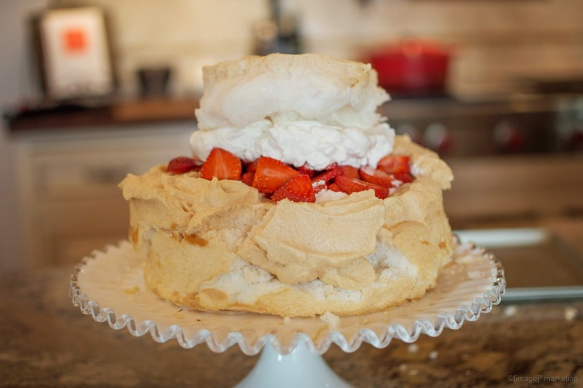 Strawberry Schaum Torte - light and airy dessert (literally) bursting with springtime strawberries and whip cream in a large baked meringue. | www.lakesidetable.com
