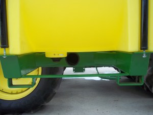 John Deere tractor showing sump for full clean out on 600 gallon tank