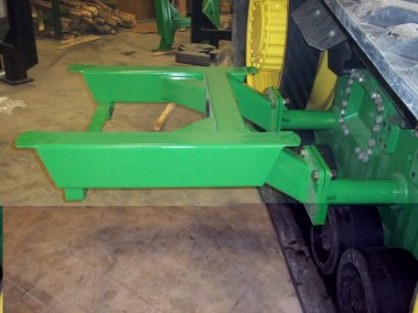 mounts into holes in track frame