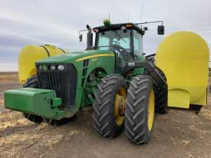 John Deere tractor with tracs and new 600 gallon side tanks