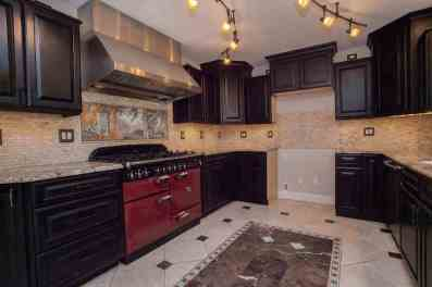 High end gas range w/professional stainless hood