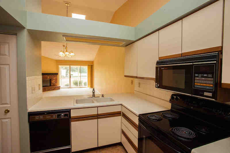 Vaulted kitchen open to GR