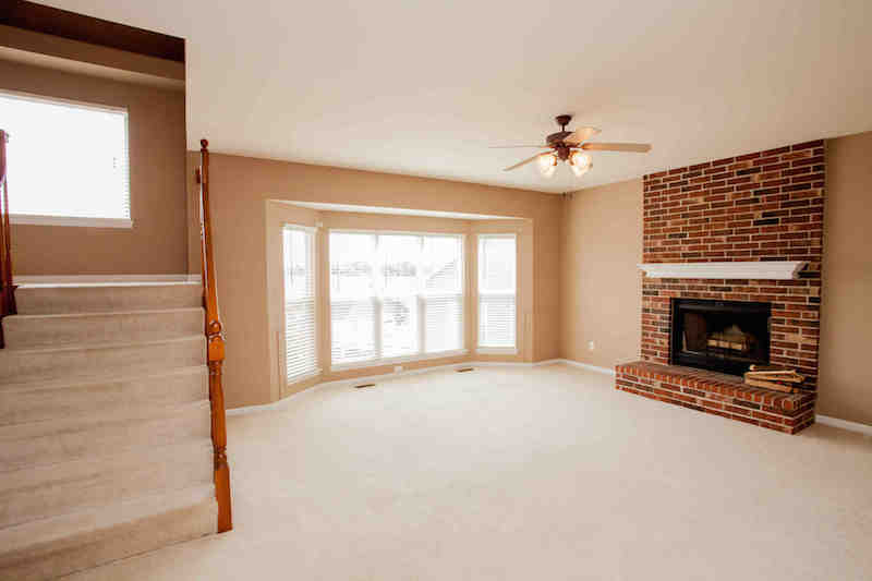 Great room w/wood burning fireplace & bay window