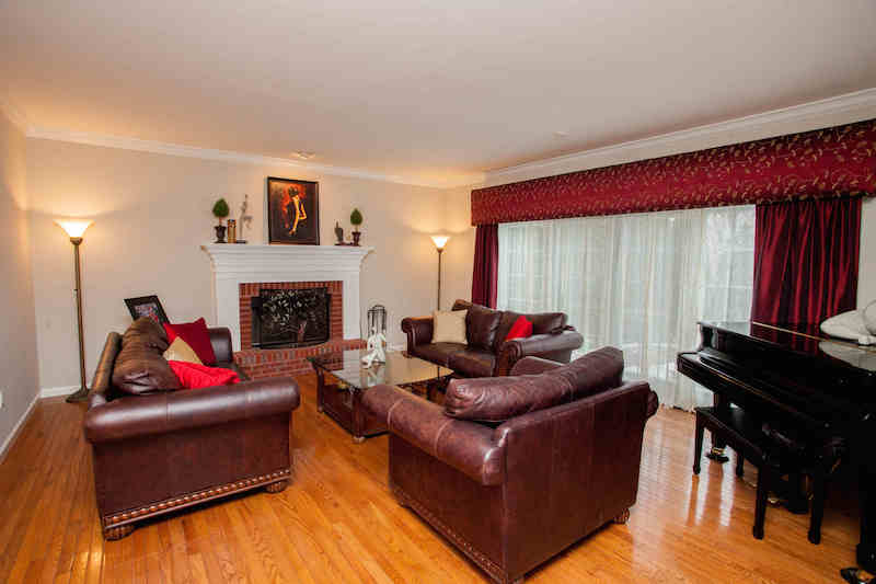 Great room w/fireplace & wood floors