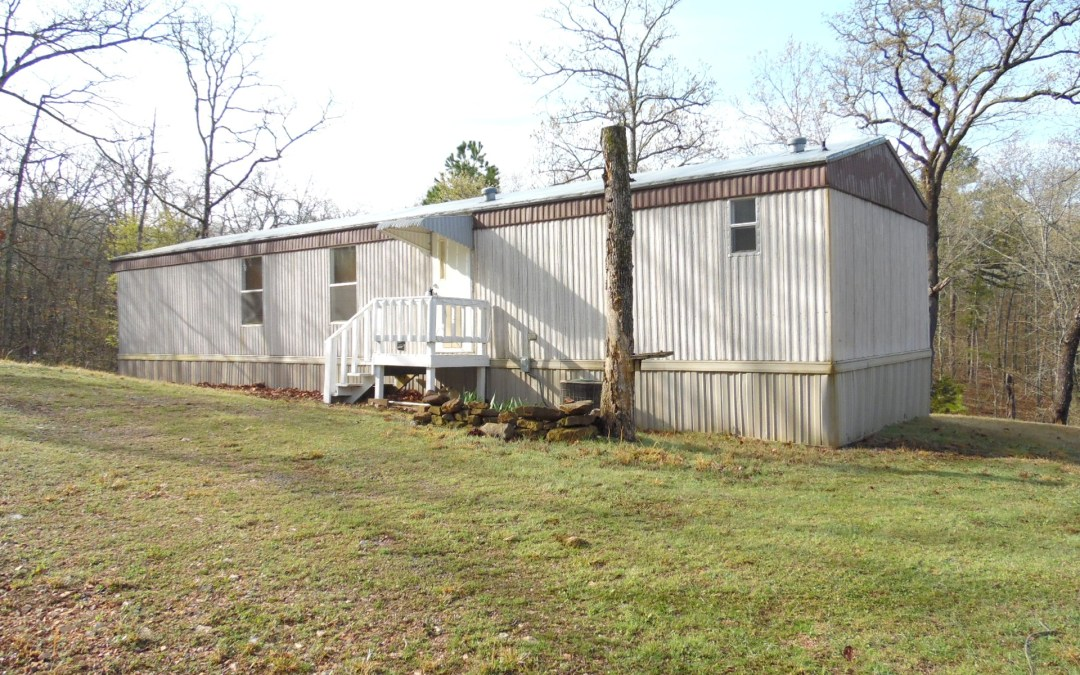 Lake Tenkiller 2 bd 2 bath home is secluded & private 2.61 acres m/l. This Very well maintained with a Open floor plan