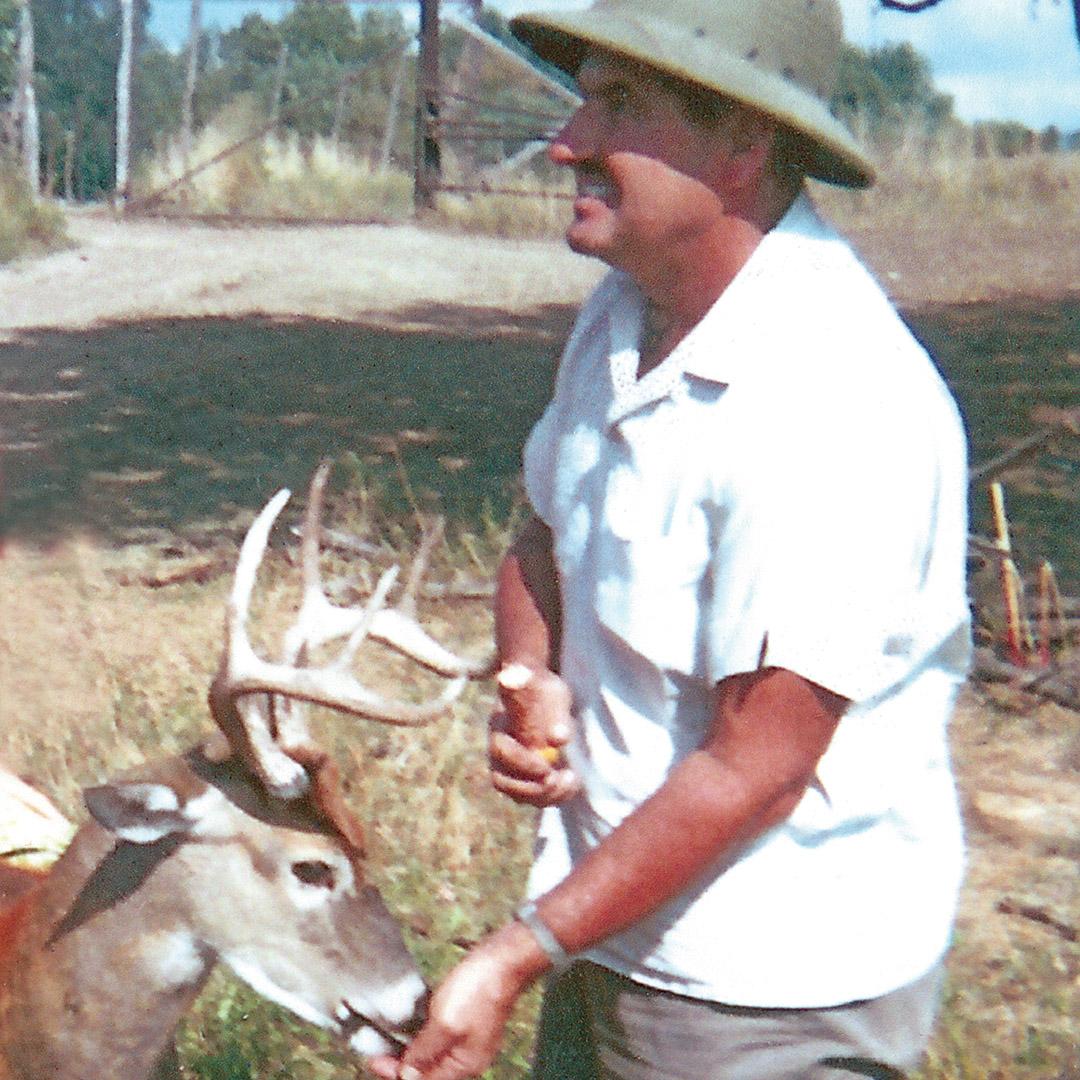 J.R. Tobias feeds a deer