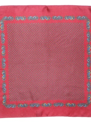 Vintage silk handkerchief with a red background.