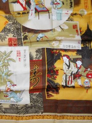 Pictorial silk scarf depicting various scenes