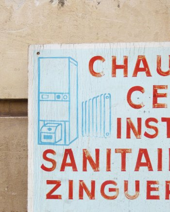 Cartel publicitario francés pintado a mano