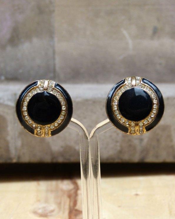 Pendientes redondos 90's de esmalte negro e incrustaciones.