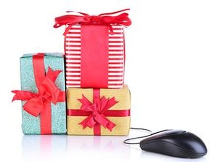 Gifts and computer mouse isolated on white