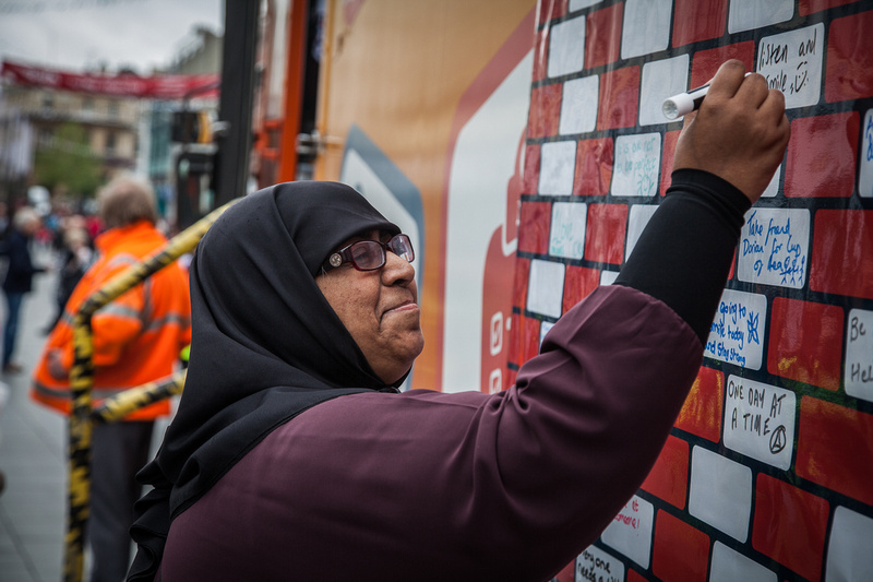 Yasmin signing the pledge wall are ruok event