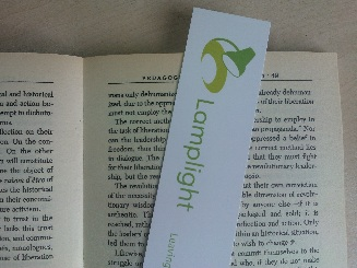 A picture of a Lamplight bookmark in a book