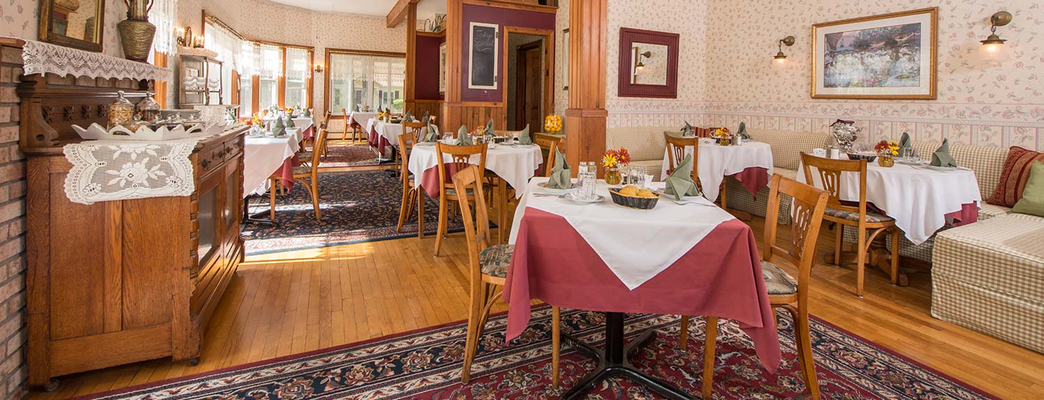 Breakfast tables in Dining Room - Lamplight Inn, a Lake George bed and breakfast.